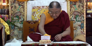 HH the Sakya Gongma Trichen Rinpoche cutting Birthday Cakes.