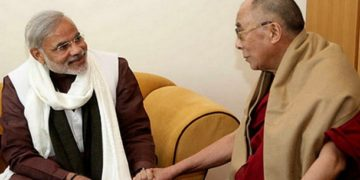 His Holiness the Dalai Lama with Narendra Modi.
